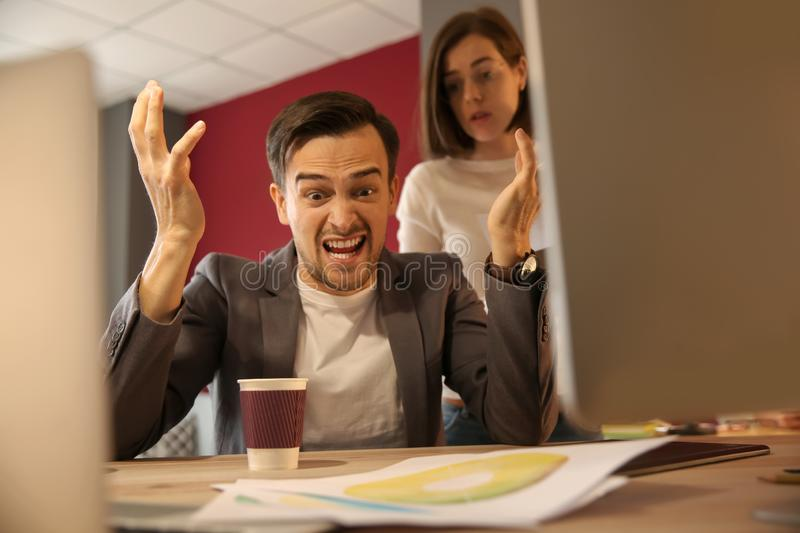 Stressed IT specialist missing deadlines in office royalty free stock image