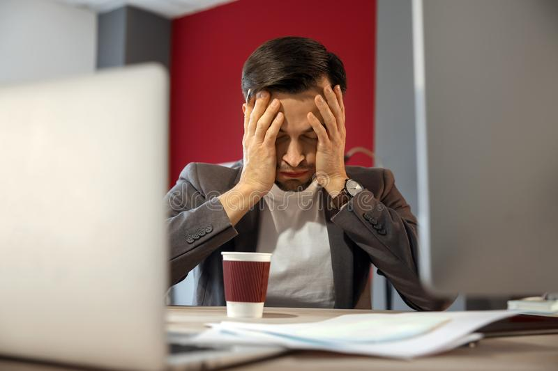 Stressed IT specialist missing deadlines in office royalty free stock images
