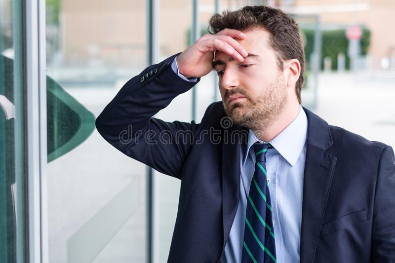 Face portrait of desperate businessman after big trouble at work. Stressed and tired manager face expression portrait stock image