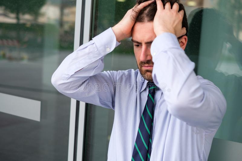 Face portrait of desperate businessman after big trouble at work. Stressed and tired manager face expression portrait royalty free stock photo