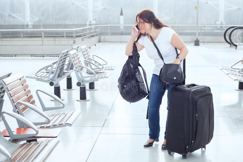 Stressed troubled woman in the airport stock photo