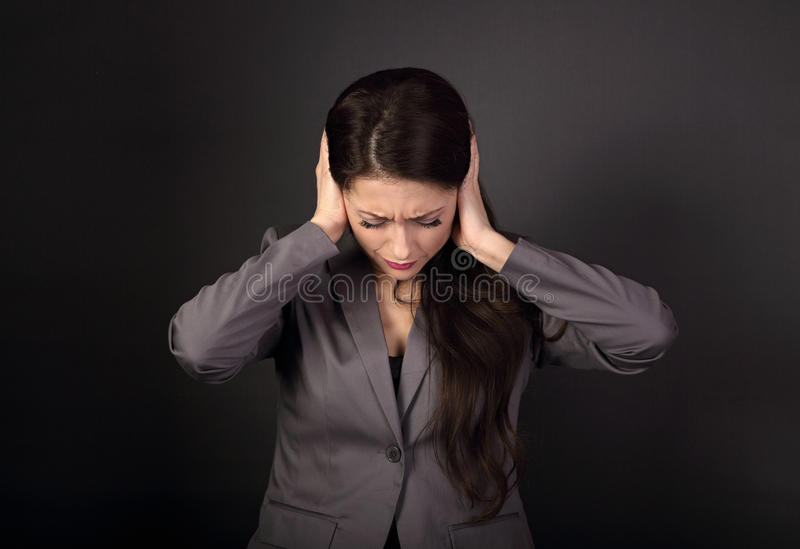 Stressed unhappy business woman in grey suit closed ears the han stock image