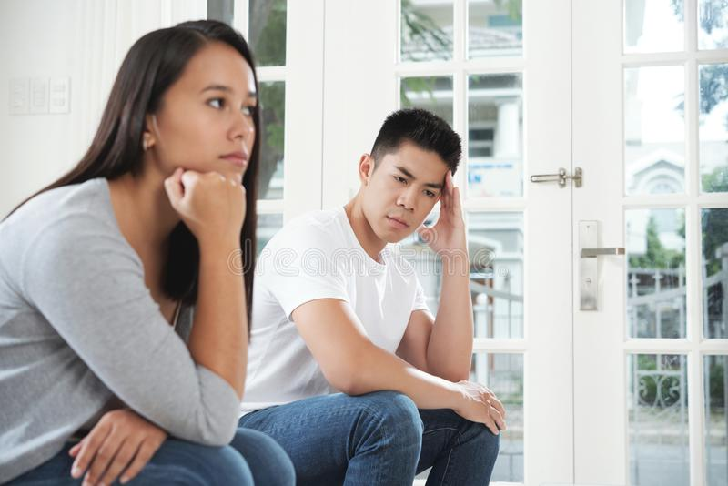 Domestic quarrel. Stressed unhappy young men after domestic quarrel with wife royalty free stock photography