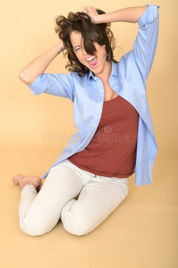 Stressed Unhappy Young Woman Sitting on the Floor Screaming royalty free stock photos