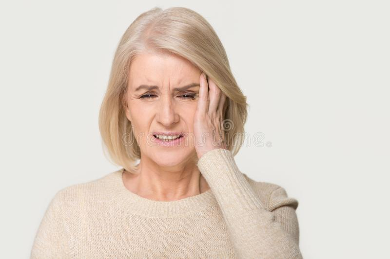 Stressed upset middle aged woman suffering from terrible headache concept royalty free stock images