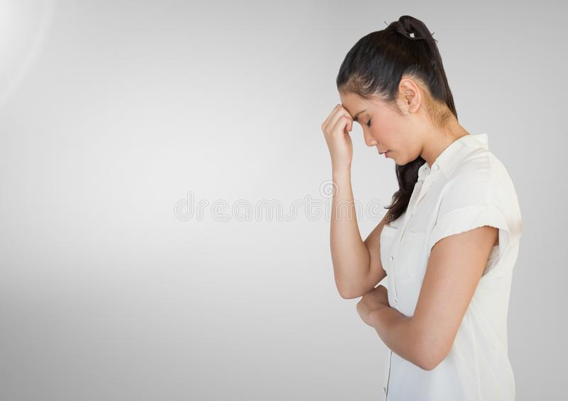 Stressed woman against grey backgrond. Digital composite of Stressed woman against grey backgrond stock images