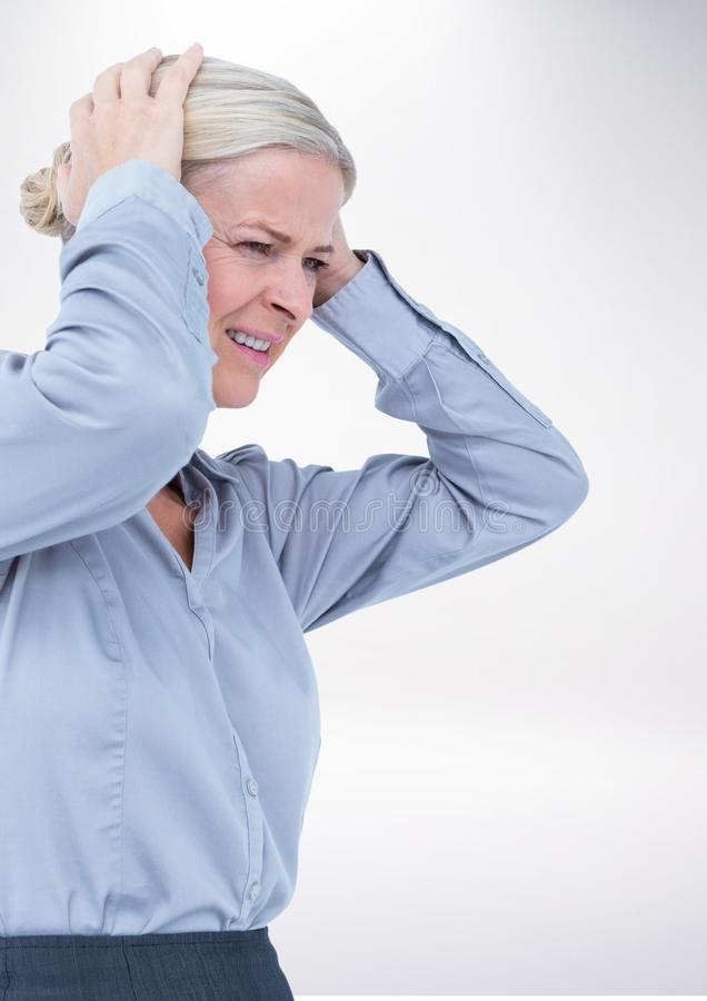 Stressed woman against grey background royalty free stock photo