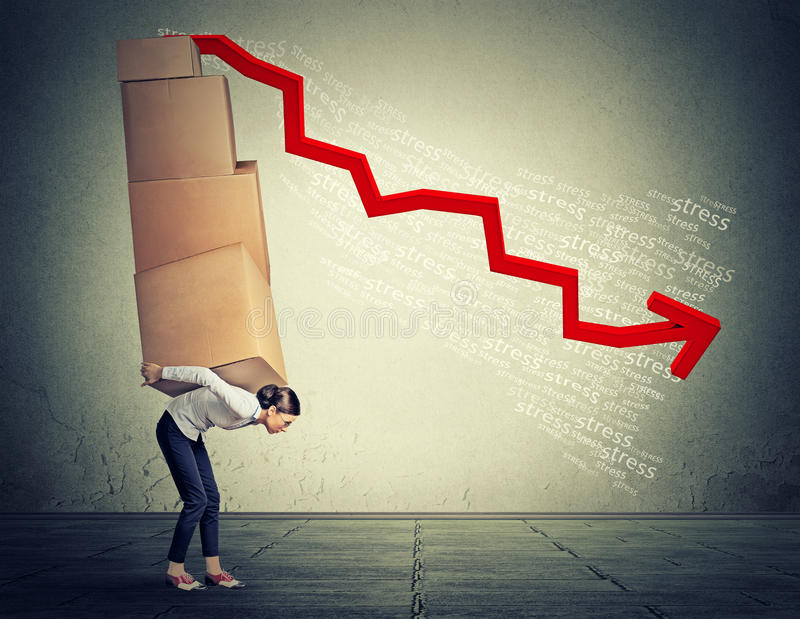 Stressed woman carrying pile of boxes stock image
