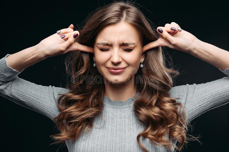 Stressed woman feeling negative emotions Isolated on gray background royalty free stock photo