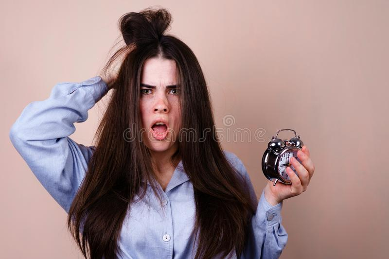 Stressed woman hold alarm clock and head, deadline stock photos
