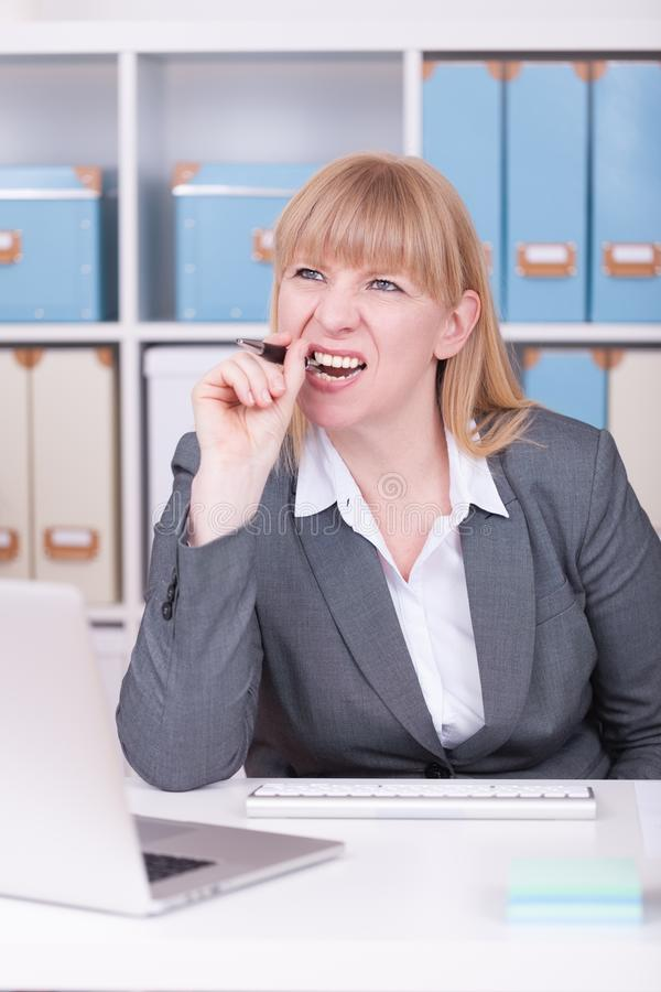 Stressed woman at the office. Concept for burnout and overwork in business situations stock photography
