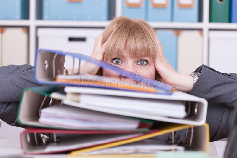 Stressed woman at the office. Concept for burnout and overwork in business situations stock photos