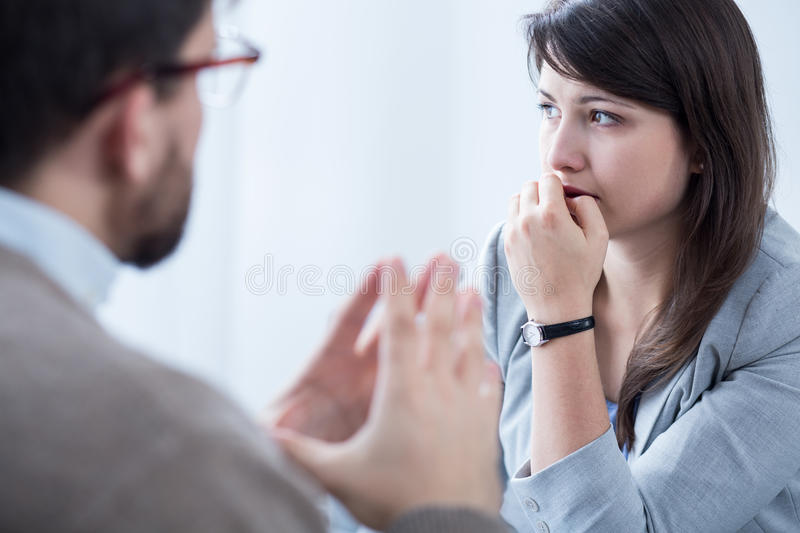 Stressed woman with personal coach royalty free stock photos