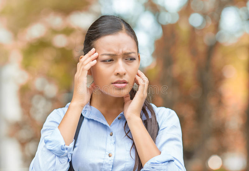 Stressed woman standing in park stock photo
