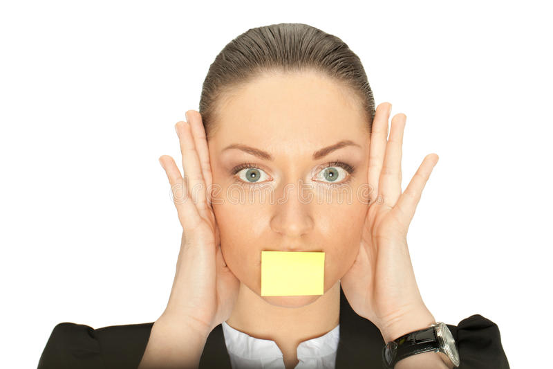 Stressed woman with sticker on mouth. Hear nothing, say nothing (put your message on sticker stock photography