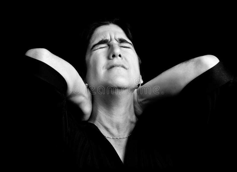 Stressed woman suffering from neck pain royalty free stock photos