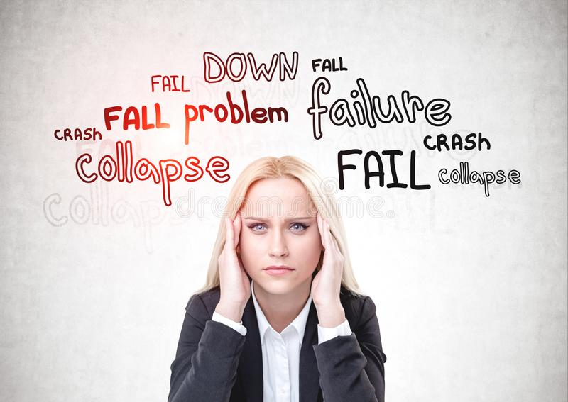 Stressed woman in suit, failure concept royalty free stock image