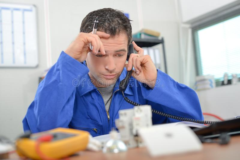 Stressed worker on telephone royalty free stock photos