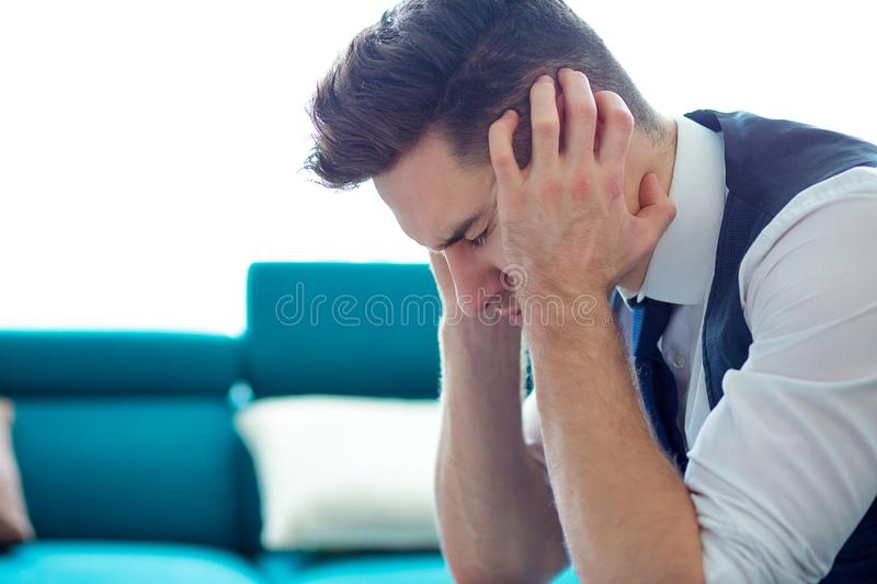 Stressed young business man with hands on head feeling worried royalty free stock photos