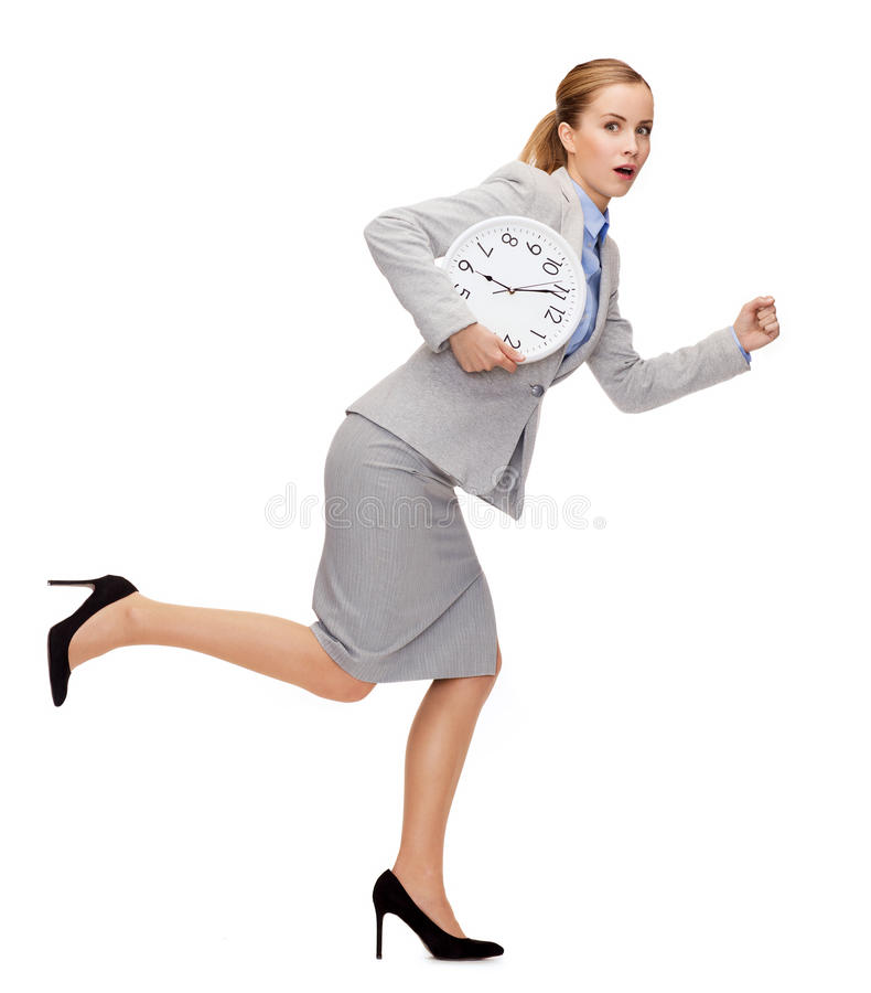 Stressed young businesswoman with clock running stock photos