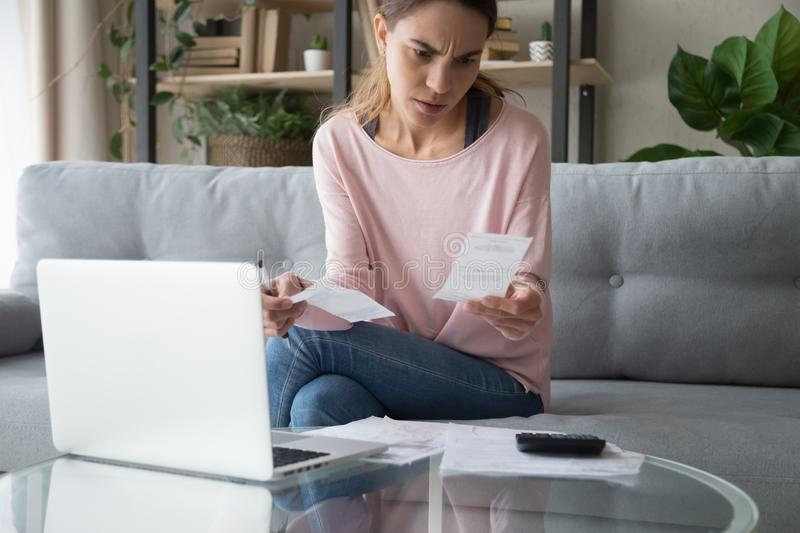Stressed young woman hold papers calculate bills worried about debt stock photography