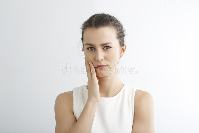Stressed young woman portrait against white background. stock photos