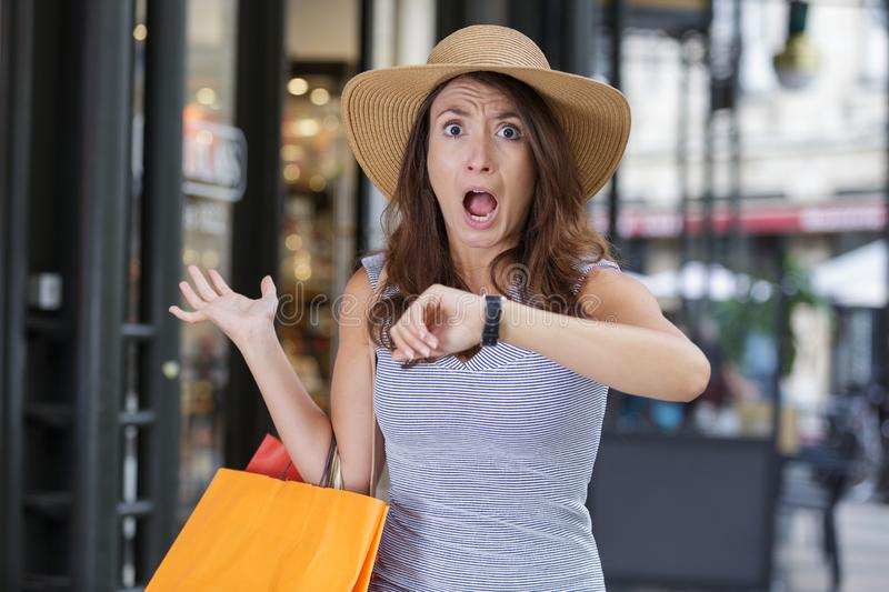 Stressed young woman with shopping bags stock photos