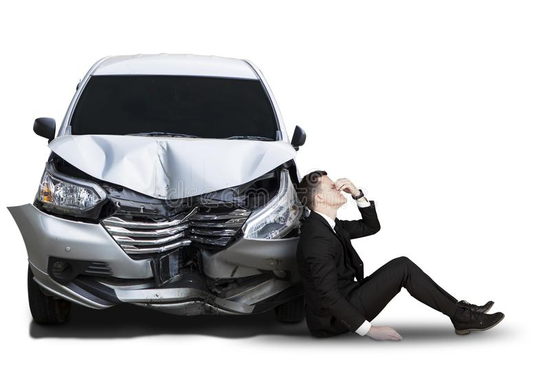 Caucasian businessman with broken car royalty free stock photography