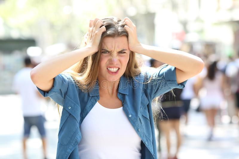 Stressful furious girl in the street stock image
