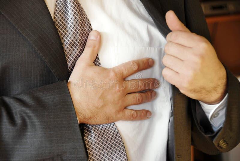 Stressful job troubles. Businessman hand on chest, stressful job troubles royalty free stock photography