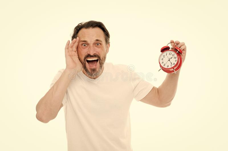 Stressful times. Man bearded mature guy hold clock isolated on white. Man with beard check what time is it. Time royalty free stock photo