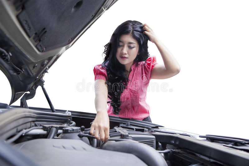Stressful woman checking broken car machine stock photo