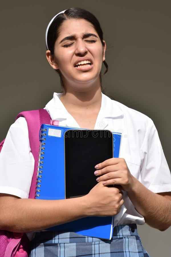 Stressig katolsk colombiansk kvinnlig student Wearing School Uniform arkivfoto