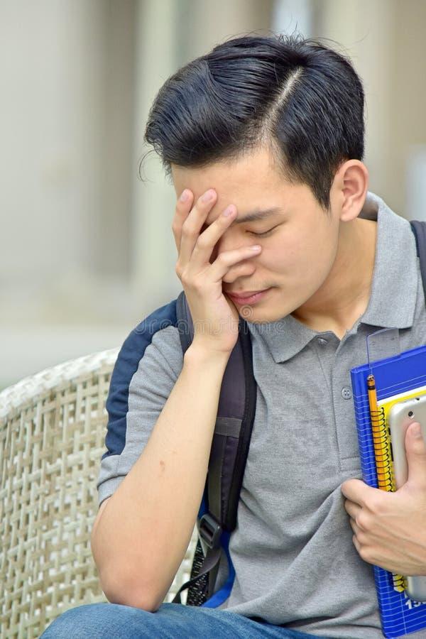 Stresującej szkoły wyższa Różnorodny Męski uczeń zdjęcie stock