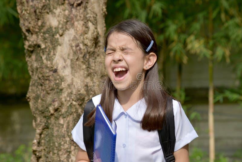 Stresujący Azjatycki Żeński uczeń Z książkami zdjęcia stock