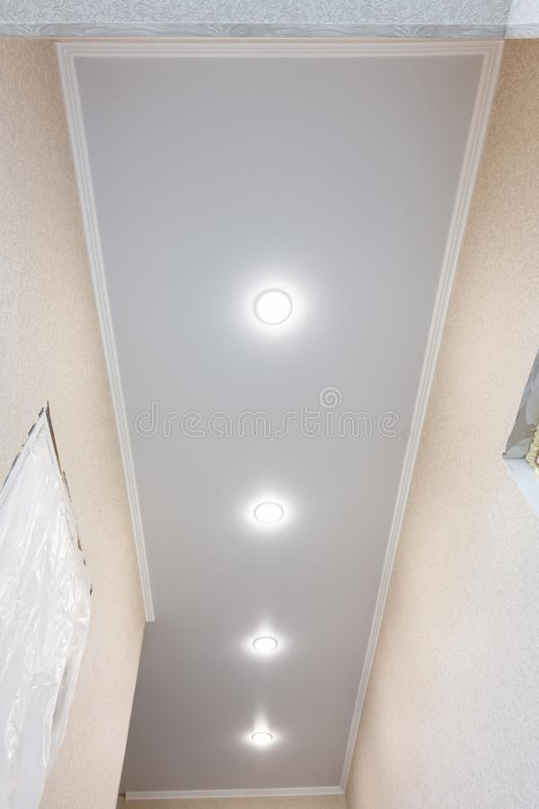 Stretch ceiling in a long narrow corridor royalty free stock images