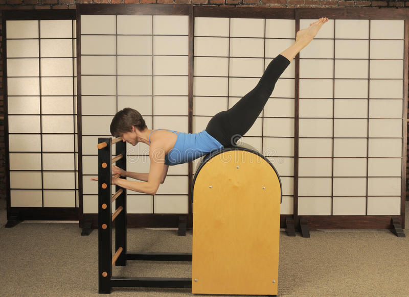 Stretch on Pilates Barrel stock images