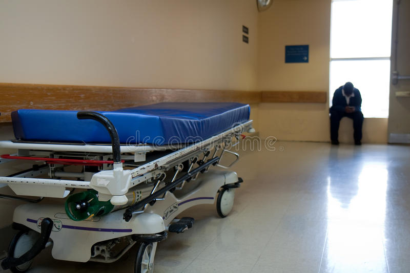 Stretcher and the hospital worker royalty free stock photos