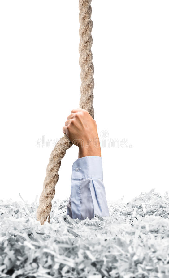 Stretches hand from white shredded papers royalty free stock photography