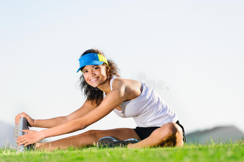 Stretching athlete stock images