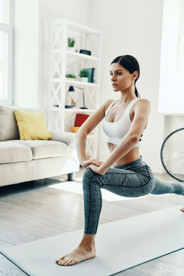 Stretching away the stress. royalty free stock photo