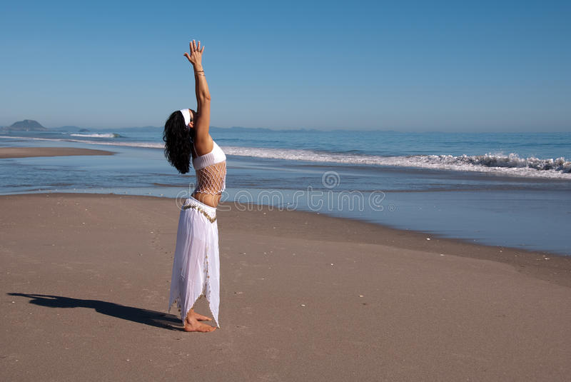 Stretching at beach royalty free stock images