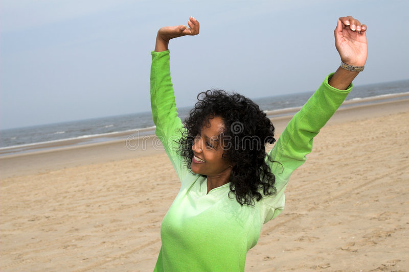 Stretching on the beach royalty free stock photos