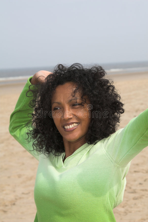 Stretching on the beach royalty free stock images