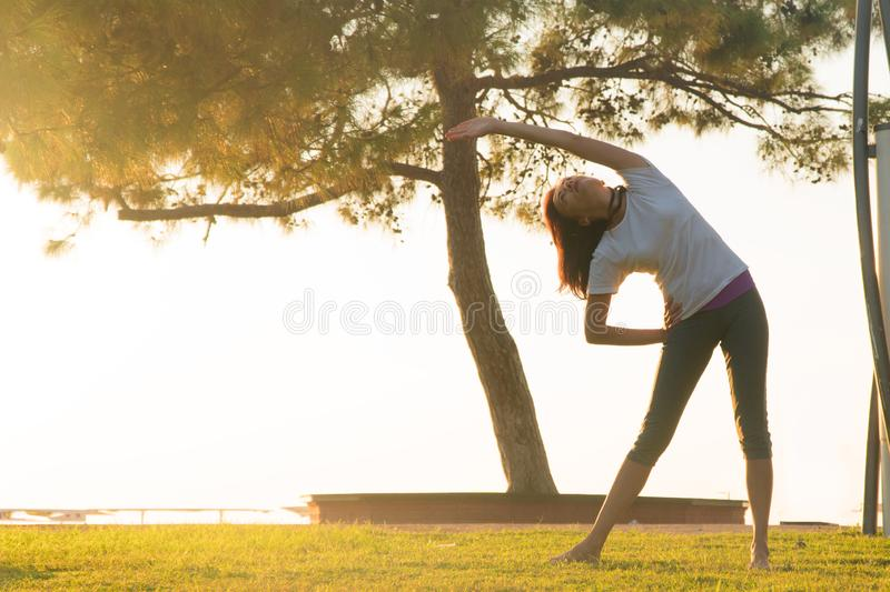 Girl doing stretching before running. royalty free stock images