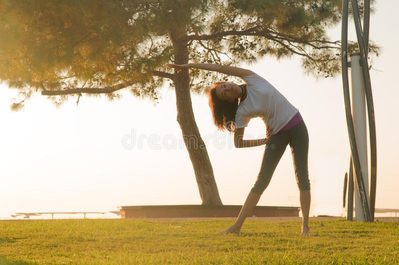 girl doing stretching before running. stock photography