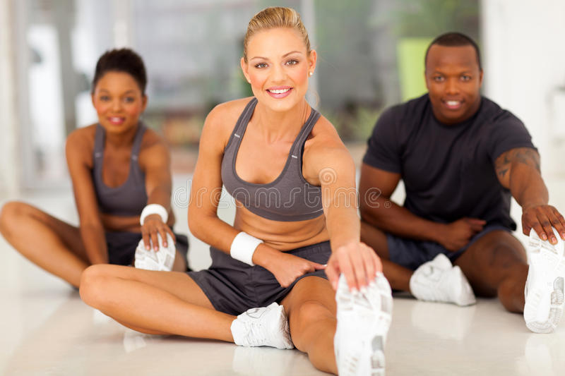 Stretching before exercise royalty free stock photography