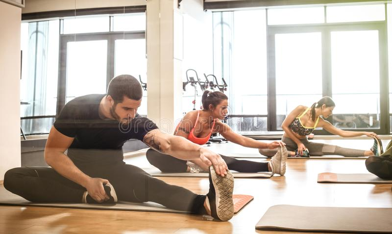 Stretching after exercise. Small group of people . Healthy lifestyle royalty free stock image
