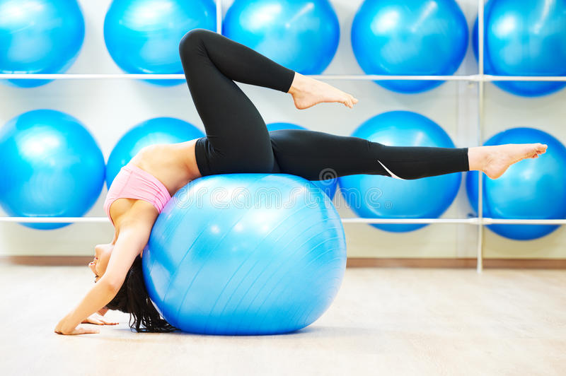 Stretching exercises with fitness ball royalty free stock photo
