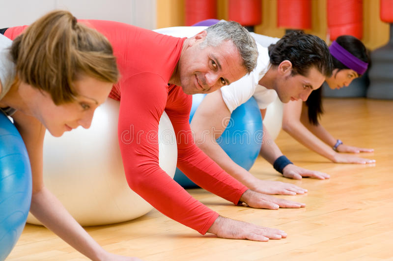 Stretching With Fitness Ball At Gym Stock Images